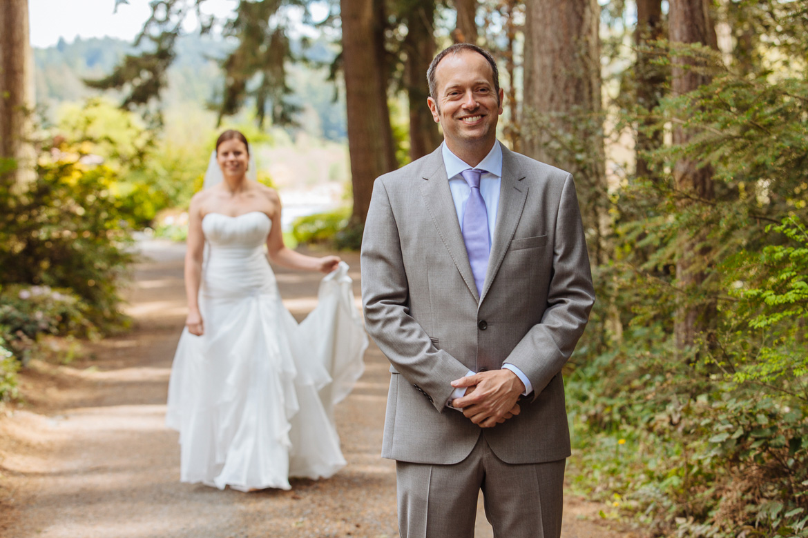 Bride and groom during first look at Fireseed Catering wedding on Whidbey Island, WA