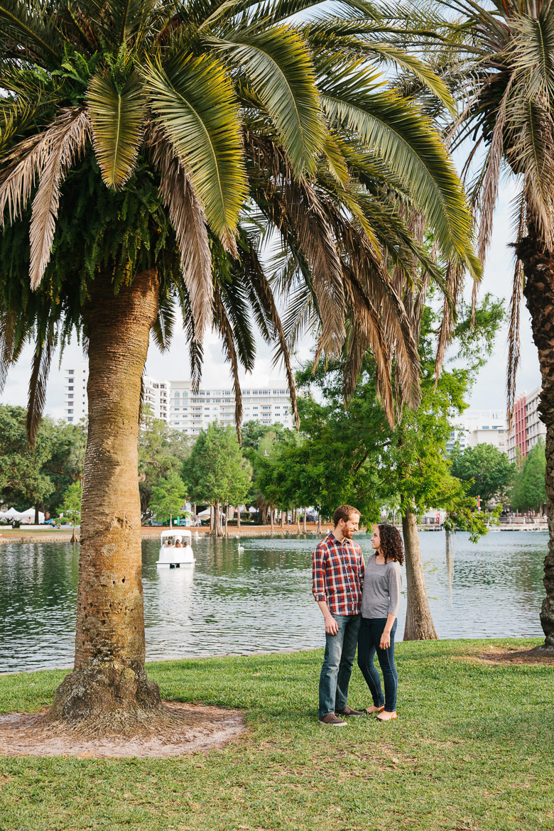 Couple at Lake Eola Park for engagement photo session in Orlando, FL